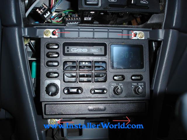 remove 4 8mm/philips screws, then remove and unplug radio